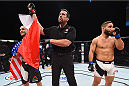 LAS VEGAS, NV - DECEMBER 11:  Frankie Edgar (left) is declared the winner over Chad Mendes (right) in their featherweight bout during the TUF Finale event inside The Chelsea at The Cosmopolitan of Las Vegas on December 11, 2015 in Las Vegas, Nevada.  (Photo by Jeff Bottari/Zuffa LLC/Zuffa LLC via Getty Images) *** Local Caption *** Frankie Edgar; Chad Mendes