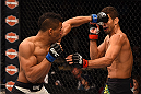 LAS VEGAS, NV - DECEMBER 12: (L-R) Kevin Lee punches Leonardo Santos of Brazil in their lightweight bout during the UFC 194 event inside MGM Grand Garden Arena on December 12, 2015 in Las Vegas, Nevada.  (Photo by Josh Hedges/Zuffa LLC/Zuffa LLC via Getty Images) *** Local Caption *** Leonardo Santos; Kevin Lee