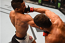 LAS VEGAS, NV - DECEMBER 12:  (R-L) Leonardo Santos of Brazil punches Kevin Lee in their lightweight bout during the UFC 194 event inside MGM Grand Garden Arena on December 12, 2015 in Las Vegas, Nevada.  (Photo by Josh Hedges/Zuffa LLC/Zuffa LLC via Getty Images) *** Local Caption *** Leonardo Santos; Kevin Lee