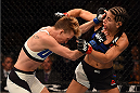 LAS VEGAS, NV - DECEMBER 12: (L-R) Jocelyn Jones-Lybarger punches Tecia Torres in their women's strawweight bout during the UFC 194 event inside MGM Grand Garden Arena on December 12, 2015 in Las Vegas, Nevada.  (Photo by Josh Hedges/Zuffa LLC/Zuffa LLC via Getty Images) *** Local Caption *** Tecia Torres; Jocelyn Jones-Lybarger