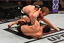 LAS VEGAS, NV - DECEMBER 12: Gunnar Nelson of Iceland (top) grapples with Demian Maia of Brazil in their welterweight bout during the UFC 194 event inside MGM Grand Garden Arena on December 12, 2015 in Las Vegas, Nevada.  (Photo by Josh Hedges/Zuffa LLC/Zuffa LLC via Getty Images) *** Local Caption *** Demian Maia; Gunnar Nelson