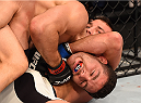 LAS VEGAS, NV - DECEMBER 12: Luke Rockhold (top) attempts to submit Chris Weidman in their UFC middleweight championship bout during the UFC 194 event inside MGM Grand Garden Arena on December 12, 2015 in Las Vegas, Nevada.  (Photo by Josh Hedges/Zuffa LLC/Zuffa LLC via Getty Images) *** Local Caption *** Chris Weidman; Luke Rockhold