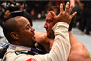 LAS VEGAS, NV - DECEMBER 12:  (L-R) UFC light heavyweight champion Daniel Cormier celebrates with Luke Rockhold after his victory over Chris Weidman in their UFC middleweight championship bout during the UFC 194 event inside MGM Grand Garden Arena on December 12, 2015 in Las Vegas, Nevada.  (Photo by Josh Hedges/Zuffa LLC/Zuffa LLC via Getty Images) *** Local Caption *** Daniel Cormier; Luke Rockhold