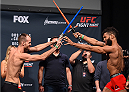 ORLANDO, FL - DECEMBER 18:   (L-R) Opponents Cole Miller and Jim Alers face off during the UFC weigh-in at the Orange County Convention Center on December 18, 2015 in Orlando, Florida. (Photo by Josh Hedges/Zuffa LLC/Zuffa LLC via Getty Images)