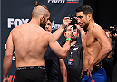 ORLANDO, FL - DECEMBER 18:   (L-R) Opponents Nik Lentz and Danny Castillo face off during the UFC weigh-in at the Orange County Convention Center on December 18, 2015 in Orlando, Florida. (Photo by Josh Hedges/Zuffa LLC/Zuffa LLC via Getty Images)
