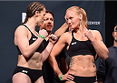 ORLANDO, FL - DECEMBER 18:   (L-R) Opponents Sarah Kaufman of Canada and Valentina Shevchenko of Russia face off during the UFC weigh-in at the Orange County Convention Center on December 18, 2015 in Orlando, Florida. (Photo by Josh Hedges/Zuffa LLC/Zuffa LLC via Getty Images)
