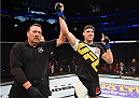 ORLANDO, FL - DECEMBER 19:  Vicente Luque celebrates his submission victory over Hayder Hassan in their welterweight bout during the UFC Fight Night event at the Amway Center on December 19, 2015 in Orlando, Florida. (Photo by Josh Hedges/Zuffa LLC/Zuffa LLC via Getty Images)