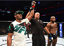 ORLANDO, FL - DECEMBER 19:   (L-R) Kamaru Usman celebrates his victory over Leon Edwards in their welterweight bout during the UFC Fight Night event at the Amway Center on December 19, 2015 in Orlando, Florida. (Photo by Josh Hedges/Zuffa LLC/Zuffa LLC via Getty Images)