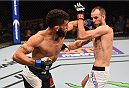 ORLANDO, FL - DECEMBER 19:   (L-R) Jim Alers punches Cole Miller in their featherweight bout during the UFC Fight Night event at the Amway Center on December 19, 2015 in Orlando, Florida. (Photo by Josh Hedges/Zuffa LLC/Zuffa LLC via Getty Images)