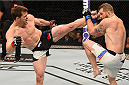 ORLANDO, FL - DECEMBER 19:   (L-R) CB Dollaway kicks Nate Marquardt in their middleweight bout during the UFC Fight Night event at the Amway Center on December 19, 2015 in Orlando, Florida. (Photo by Josh Hedges/Zuffa LLC/Zuffa LLC via Getty Images)