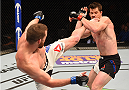 ORLANDO, FL - DECEMBER 19:   (L-R) Nate Marquardt kicks CB Dollaway in their middleweight bout during the UFC Fight Night event at the Amway Center on December 19, 2015 in Orlando, Florida. (Photo by Josh Hedges/Zuffa LLC/Zuffa LLC via Getty Images)