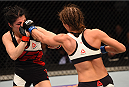 ORLANDO, FL - DECEMBER 19:   (R-L) Karolina Kowalkiewicz punches Randa Markos in their women's strawweight bout during the UFC Fight Night event at the Amway Center on December 19, 2015 in Orlando, Florida. (Photo by Josh Hedges/Zuffa LLC/Zuffa LLC via Getty Images)