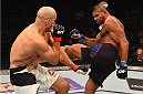 ORLANDO, FL - DECEMBER 19:   (R-L) Alistair Overeem kicks Junior dos Santos in their heavyweight bout during the UFC Fight Night event at the Amway Center on December 19, 2015 in Orlando, Florida. (Photo by Josh Hedges/Zuffa LLC/Zuffa LLC via Getty Images)