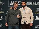 LAS VEGAS, NEVADA - DECEMBER 31:  (L-R) Stipe Miocic and Andrei Arlovski pose for a picture after facing off during the Ultimate Media Day at the MGM Grand Hotel/Casino on December 31, 2015 in Las Vegas Nevada. (Photo by Brandon Magnus/Zuffa LLC/Zuffa LLC via Getty Images)