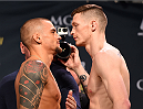 LAS VEGAS, NV - JANUARY 01:   (L-R) Opponents Dustin Poirier and Joe Duffy of Ireland face off during the UFC 195 weigh-in at the MGM Grand Conference Center on January 1, 2016 in Las Vegas, Nevada. (Photo by Josh Hedges/Zuffa LLC/Zuffa LLC via Getty Images)