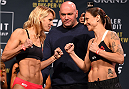 LAS VEGAS, NV - JANUARY 01:   (L-R) Opponents Justine Kish and Nina Ansaroff face off during the UFC 195 weigh-in at the MGM Grand Conference Center on January 1, 2016 in Las Vegas, Nevada. (Photo by Josh Hedges/Zuffa LLC/Zuffa LLC via Getty Images)