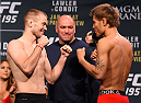 LAS VEGAS, NV - JANUARY 01:   (L-R) Opponents Michael McDonald and Masanori Kanehara of Japan face off during the UFC 195 weigh-in at the MGM Grand Conference Center on January 1, 2016 in Las Vegas, Nevada. (Photo by Josh Hedges/Zuffa LLC/Zuffa LLC via Getty Images)