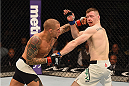 LAS VEGAS, NV - JANUARY 02: (L-R) Dustin Poirier punches Joe Duffy of Ireland in their lightweight bout during the UFC 195 event inside MGM Grand Garden Arena on January 2, 2016 in Las Vegas, Nevada.  (Photo by Josh Hedges/Zuffa LLC/Zuffa LLC via Getty Images)