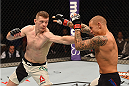 LAS VEGAS, NV - JANUARY 02: (L-R) Joe Duffy of Ireland punches Dustin Poirier in their lightweight bout during the UFC 195 event inside MGM Grand Garden Arena on January 2, 2016 in Las Vegas, Nevada.  (Photo by Josh Hedges/Zuffa LLC/Zuffa LLC via Getty Images)