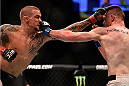 LAS VEGAS, NV - JANUARY 02: (L-R) Dustin Poirier and Joe Duffy of Ireland exchange punches in their lightweight bout during the UFC 195 event inside MGM Grand Garden Arena on January 2, 2016 in Las Vegas, Nevada.  (Photo by Jeff Bottari/Zuffa LLC/Zuffa LLC via Getty Images)