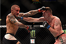 LAS VEGAS, NV - JANUARY 02: (R-L) Joe Duffy of Ireland punches Dustin Poirier in their lightweight bout during the UFC 195 event inside MGM Grand Garden Arena on January 2, 2016 in Las Vegas, Nevada.  (Photo by Jeff Bottari/Zuffa LLC/Zuffa LLC via Getty Images)