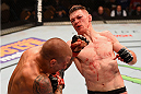 LAS VEGAS, NV - JANUARY 02: (R-L) Joe Duffy of Ireland punches Dustin Poirier in their lightweight bout during the UFC 195 event inside MGM Grand Garden Arena on January 2, 2016 in Las Vegas, Nevada.  (Photo by Josh Hedges/Zuffa LLC/Zuffa LLC via Getty Images)