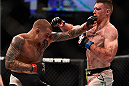 LAS VEGAS, NV - JANUARY 02: (L-R) Dustin Poirier punches Joe Duffy of Ireland in their lightweight bout during the UFC 195 event inside MGM Grand Garden Arena on January 2, 2016 in Las Vegas, Nevada.  (Photo by Jeff Bottari/Zuffa LLC/Zuffa LLC via Getty Images)