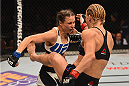 LAS VEGAS, NV - JANUARY 02: (R-L) Justine Kish kicks Nina Ansaroff in their women's strawweight bout during the UFC 195 event inside MGM Grand Garden Arena on January 2, 2016 in Las Vegas, Nevada.  (Photo by Josh Hedges/Zuffa LLC/Zuffa LLC via Getty Images)