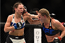 LAS VEGAS, NV - JANUARY 02: (R-L) Justine Kish punches Nina Ansaroff in their women's strawweight bout during the UFC 195 event inside MGM Grand Garden Arena on January 2, 2016 in Las Vegas, Nevada.  (Photo by Jeff Bottari/Zuffa LLC/Zuffa LLC via Getty Images)