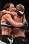 LAS VEGAS, NV - JANUARY 02: (L-R) Nina Ansaroff and Justine Kish embrace after their women's strawweight bout during the UFC 195 event inside MGM Grand Garden Arena on January 2, 2016 in Las Vegas, Nevada.  (Photo by Jeff Bottari/Zuffa LLC/Zuffa LLC via Getty Images)