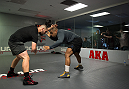 SAN JOSE, CA - JANUARY 05:  (L-R) Cain Velasquez works out  with light heavyweight champion Daniel Cormier during a media day at American Kickboxing Academy on January 5, 2016 in San Jose, California.  (Photo by Brandon Magnus/Zuffa LLC/Zuffa LLC via Getty Images)
