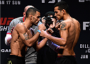BOSTON, MA - JANUARY 16:  (L-R) Opponents Rob Font and Joey Gomez face off during the UFC weigh-in at the Wang Theatre on January 16, 2016 in Boston, Massachusetts. (Photo by Jeff Bottari/Zuffa LLC/Zuffa LLC via Getty Images)