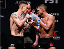 BOSTON, MA - JANUARY 16:  (L-R) Opponents Paul Felder and Daron Cruickshank face off during the UFC weigh-in at the Wang Theatre on January 16, 2016 in Boston, Massachusetts. (Photo by Jeff Bottari/Zuffa LLC/Zuffa LLC via Getty Images)