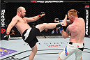 BOSTON, MA - JANUARY 17:  (L-R) Tim Boetsch kicks Ed Herman in their light heavyweight bout during the UFC Fight Night event inside TD Garden on January 17, 2016 in Boston, Massachusetts. (Photo by Jeff Bottari/Zuffa LLC/Zuffa LLC via Getty Images)