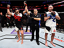 BOSTON, MA - JANUARY 17:  Patrick Cote (L) of Canada celebrates after his TKO victory over Ben Saunders in their welterweight bout during the UFC Fight Night event inside TD Garden on January 17, 2016 in Boston, Massachusetts. (Photo by Jeff Bottari/Zuffa LLC/Zuffa LLC via Getty Images)