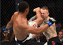 BOSTON, MA - JANUARY 17:  (L-R) Francisco Trinaldo of Brazil kicks Ross Pearson of England in their lightweight bout during the UFC Fight Night event inside TD Garden on January 17, 2016 in Boston, Massachusetts. (Photo by Jeff Bottari/Zuffa LLC/Zuffa LLC via Getty Images)