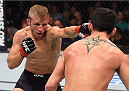 BOSTON, MA - JANUARY 17:  (L-R) TJ Dillashaw punches Dominick Cruz in their UFC bantamweight championship bout during the UFC Fight Night event inside TD Garden on January 17, 2016 in Boston, Massachusetts. (Photo by Jeff Bottari/Zuffa LLC/Zuffa LLC via Getty Images)