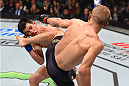 BOSTON, MA - JANUARY 17:  (R-L) TJ Dillashaw kicks Dominick Cruz in their UFC bantamweight championship bout during the UFC Fight Night event inside TD Garden on January 17, 2016 in Boston, Massachusetts. (Photo by Jeff Bottari/Zuffa LLC/Zuffa LLC via Getty Images)