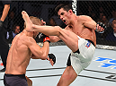 BOSTON, MA - JANUARY 17:  (R-L) Dominick Cruz kicks TJ Dillashaw in their UFC bantamweight championship bout during the UFC Fight Night event inside TD Garden on January 17, 2016 in Boston, Massachusetts. (Photo by Jeff Bottari/Zuffa LLC/Zuffa LLC via Getty Images)