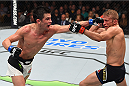 BOSTON, MA - JANUARY 17:  (L-R) Dominick Cruz punches TJ Dillashaw in their UFC bantamweight championship bout during the UFC Fight Night event inside TD Garden on January 17, 2016 in Boston, Massachusetts. (Photo by Jeff Bottari/Zuffa LLC/Zuffa LLC via Getty Images)