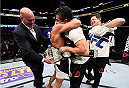 BOSTON, MA - JANUARY 17:  Dominick Cruz celebrates his split-decision victory over TJ Dillashaw in their UFC bantamweight championship bout during the UFC Fight Night event inside TD Garden on January 17, 2016 in Boston, Massachusetts. (Photo by Jeff Bottari/Zuffa LLC/Zuffa LLC via Getty Images)