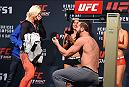 LAS VEGAS, NV - FEBRUARY 05:  Alex Nicholson (R) proposes to girlfriend Hannah Goldy on stage during the UFC Fight Night weigh-in at the MGM Grand Conference Center on February 5, 2016 in Las Vegas, Nevada. (Photo by Josh Hedges/Zuffa LLC/Zuffa LLC via Getty Images)