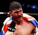 LONDON, ENGLAND - FEBRUARY 27:  A bloody and battered Michael 'The Count' Bisping of England celebrates victory over Anderson 'The Spider' Silva of Brazil in their Middleweight bout during the UFC Fight Night held at at Indigo at The O2 Arena on February 27, 2016 in London, England.  (Photo by Dean Mouhtaropoulos/Zuffa LLC/Zuffa LLC via Getty Images)