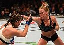 LAS VEGAS, NV - MARCH 05: (R-L) Holly Holm punches Miesha Tate in their UFC women's bantamweight championship bout during the UFC 196 event inside MGM Grand Garden Arena on March 5, 2016 in Las Vegas, Nevada.  (Photo by Josh Hedges/Zuffa LLC/Zuffa LLC via Getty Images) *** Local Caption *** Holly Holm; Miesha Tate
