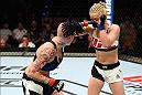 BRISBANE, AUSTRALIA - MARCH 20:  (L-R) Bec Rawlings of Australia punches Seohee Ham of South Korea in their women's strawweight bout during the UFC Fight Night event at the Brisbane Entertainment Centre on March 20, 2016 in Brisbane, Australia. (Photo by Josh Hedges/Zuffa LLC/Zuffa LLC via Getty Images)