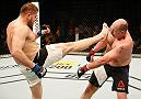 ZAGREB, CROATIA - APRIL 10:   (L-R) Marcin Tybura kicks Timothy Johnson in their heavyweight bout during the UFC Fight Night event at the Arena Zagreb on April 10, 2016 in Zagreb, Croatia. (Photo by Srdjan Stevanovic/Zuffa LLC/Zuffa LLC via Getty Images)