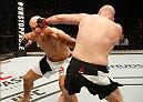 ZAGREB, CROATIA - APRIL 10:   (R-L) Ben Rothwell punches Junior Dos Santos in their heavyweight bout during the UFC Fight Night event at the Arena Zagreb on April 10, 2016 in Zagreb, Croatia. (Photo by Srdjan Stevanovic/Zuffa LLC/Zuffa LLC via Getty Images)