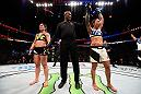 TAMPA, FL - APRIL 16:   (R-L) Raquel Pennington celebrates her victory over Bethe Correira in their women's bantamweight bout during the UFC Fight Night event at Amalie Arena on April 16, 2016 in Tampa, Florida. (Photo by Jeff Bottari/Zuffa LLC/Zuffa LLC via Getty Images)