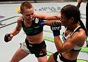 TAMPA, FL - APRIL 16:  (L-R) Rose Namajunas punches Tecia Torres in their women's strawweight bout during the UFC Fight Night event at Amalie Arena on April 16, 2016 in Tampa, Florida. (Photo by Jeff Bottari/Zuffa LLC/Zuffa LLC via Getty Images)
