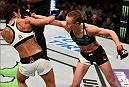 TAMPA, FL - APRIL 16:  (R-L) Rose Namajunas punches Tecia Torres in their women's strawweight bout during the UFC Fight Night event at Amalie Arena on April 16, 2016 in Tampa, Florida. (Photo by Jeff Bottari/Zuffa LLC/Zuffa LLC via Getty Images)